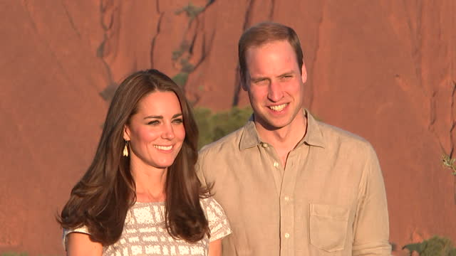 exterior shots duke & duchess of cambridge, william and catherine pose for photographs at ayers rock - 2014 stock-videos und b-roll-filmmaterial