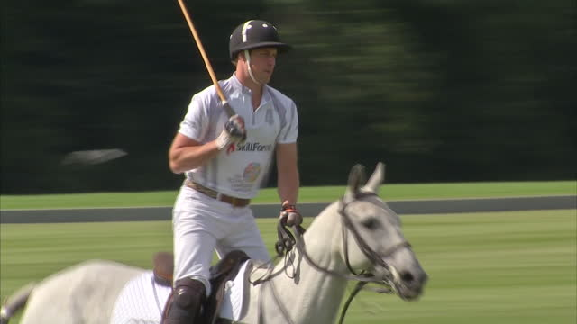 exterior shots Duke of Cambridge riding horse taking part in Polo match Prince William plays Polo first engagement since becoming a father at Coworth...