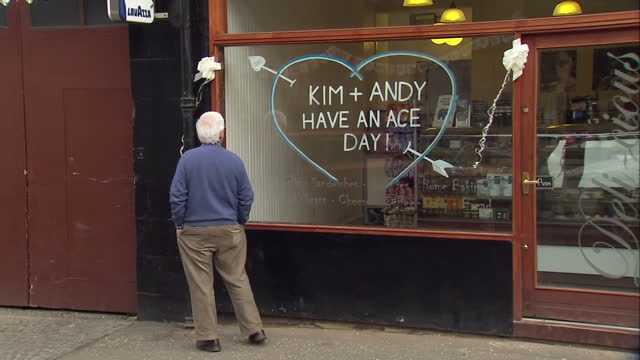 exterior shots dunblane preparations ahead of andy murray and kim sears wedding including good luck message on shop front and andy murray's gold... - dunblane stock videos & royalty-free footage