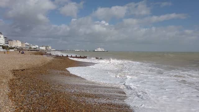 exterior shots eastbourne beach after storm with rough sea and large waves crashing onto beach and break water - non us film location stock videos & royalty-free footage