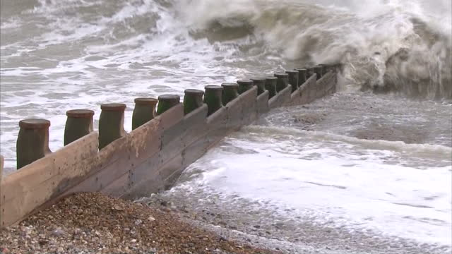 exterior shots eastbourne beach before storm with rough sea and large waves crashing onto beach and break water huge storm forecast to hit uk on... - 2013 stock videos & royalty-free footage
