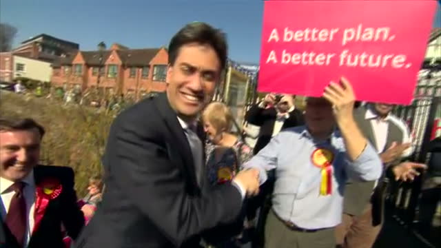 exterior shots ed miliband, labour party leader arriving at chester racecourse, interior shots ed miliband posing for photos with supporters on april... - 英国チェスター点の映像素材/bロール