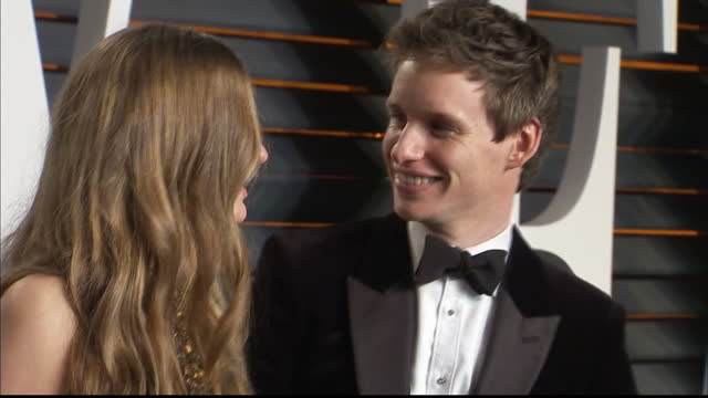 Exterior shots Eddie Redmayne actor and wife Hannah Bagshawe on Vanity Fair red carpet posing for photographers on February 28 2016 in Hollywood...