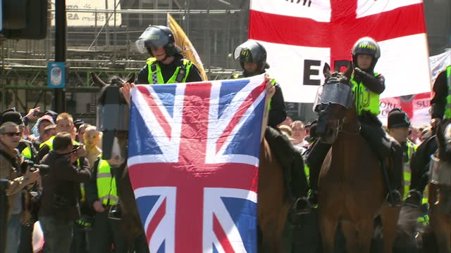 exterior shots edl supporters walk with british & english flags & chanting. aftermath of woolwich attack on may 25, 2013 in newcastle, england - newcastle upon tyne stock videos & royalty-free footage