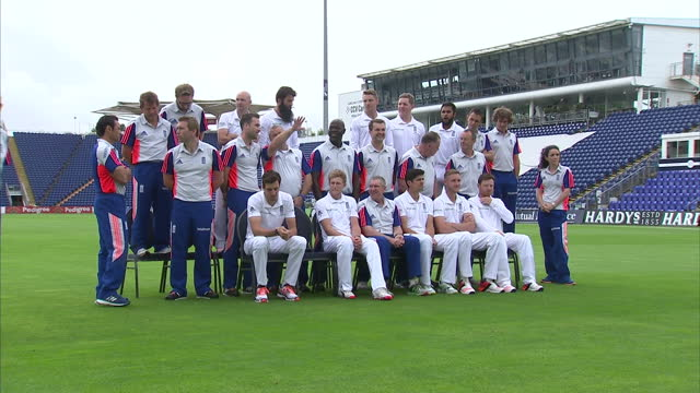 exterior shots england cricket players on pitch at swalec stadium for team photograph with coaches ahead of first ashes test match. on july 07, 2015... - チーム写真点の映像素材/bロール