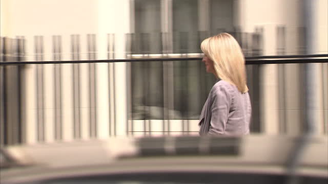 exterior shots esther mcvey walks out of 10 downing st & pose for photo opportunity before walking out towards back entrance of downing st. on july... - 内閣改造点の映像素材/bロール