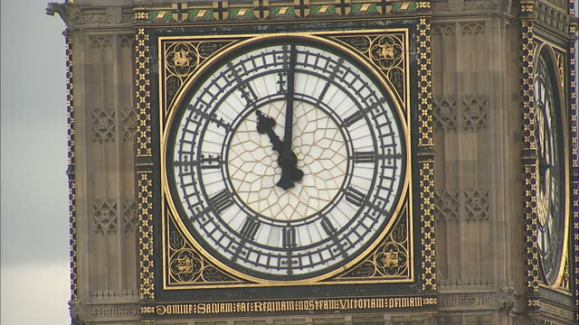 exterior shots face of big ben approaching 11 o'clock on may 08, 2015 in london, england. - 70周年点の映像素材/bロール