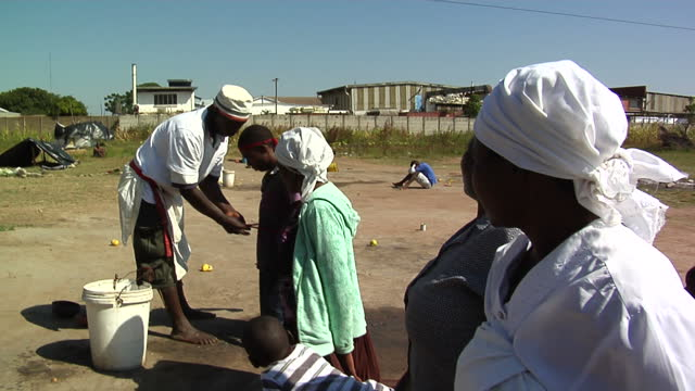 exterior shots faith healer performing ritual on people on april 18, 2012 in harare, zimbabwe. - recovery stock videos & royalty-free footage