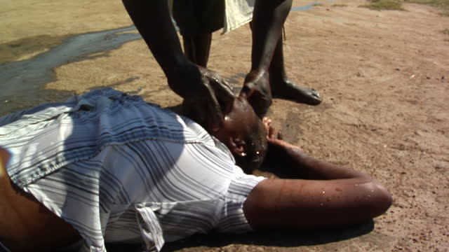 exterior shots faith healer performing ritual on woman on april 18, 2012 in harare, zimbabwe. - recovery stock videos & royalty-free footage