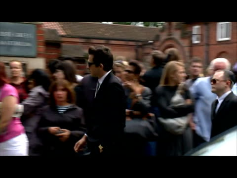 exterior shots family members & mourners including mitch winehouse & mark ronson arrive & gather outside golders green crematorium sky news archival... - mourner stock videos & royalty-free footage