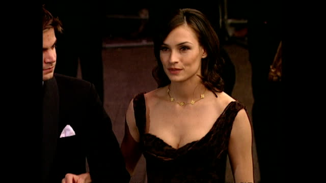 exterior shots famke janssen actress and bond girl with her husband kip williams director on the red carpet for the premiere of goldeneye the... - bond girl fictional character stock videos & royalty-free footage