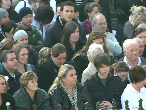 exterior shots fans, mourners outside church listening to ronan keating's tribute to stephen gately. stephen gately funeral - ronan keatings tribute... - ronan keating stock videos & royalty-free footage