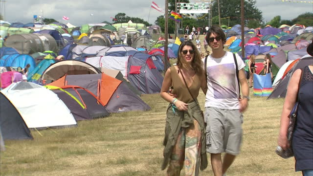 exterior shots festival goers walking about camping area of latitude music festival. on july 18, 2015 in southwold, england. - お祭り好き点の映像素材/bロール