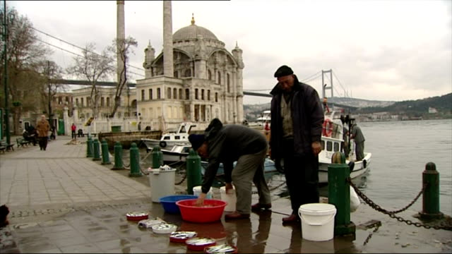 exterior shots fishermen near ortakoy mosque shots of bosphorus bridge on november 09 2006 in istanbul turkey - ortakoy mosque stock videos and b-roll footage