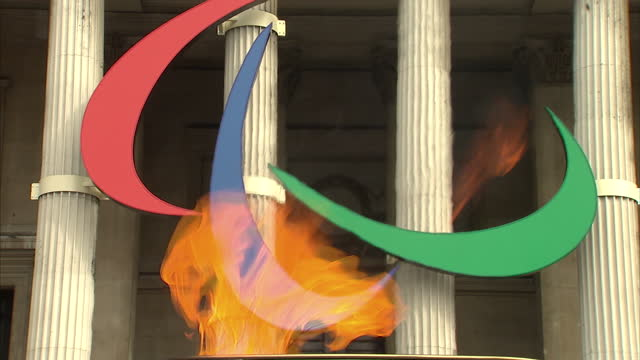 exterior shots flames from cauldron burning in front of the paralympic logo in trafalgar square paralympic logo & cauldron flames on august 24, 2012... - flame stock videos & royalty-free footage