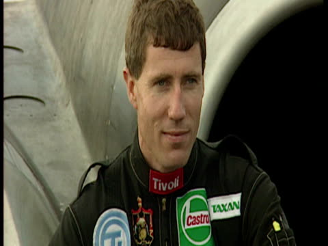 exterior shots flight lieutenant andy green driver posing for photos in front of thrust ssc car general shot thrust ssc being towed across runway... - 1996 stock videos & royalty-free footage