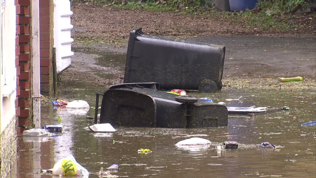 exterior shots flood waters & rising water surrounding the town of morpeth with benches & bins submerged. exterior shots high rising flood water... - northumberland video stock e b–roll