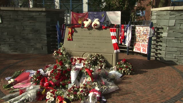 exterior shots flowers and tributes at the hillsborough memorial outside hillsborough football stadium, on day the hillsborough inquest ruled fans... - hillsborough stadium stock videos & royalty-free footage