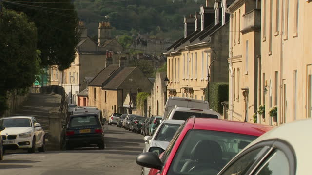 exterior shots focus pan from railing to terraced houses various of terraced housing on spring weather day in bath england on 30th april 2017 - somerset england stock videos & royalty-free footage