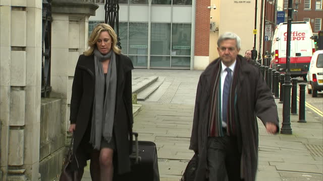 exterior shots former cabinet minister chris huhne mp arrives at court with his lawyer chris huhne arrives at court on january 08, 2013 in london,... - lawyer stock videos & royalty-free footage