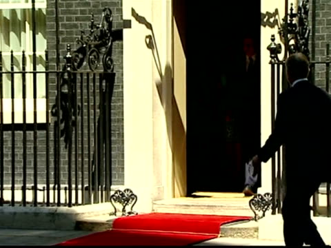 Exterior shots Former Prime Minister Tony Blair walks from car in Downing Street walks over to greet David Samantha Cameron outside Number 10 all...