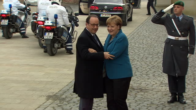 exterior shots francois hollande french president arrives at schloss herrenhausen palace and greets angela merkel german chancellor ahead of g5... - アンゲラ・メルケル点の映像素材/bロール