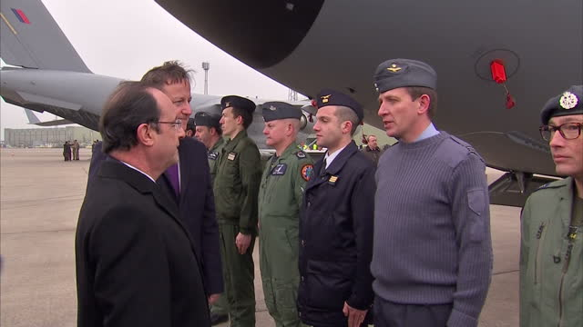 vídeos de stock, filmes e b-roll de exterior shots francois hollande french president meeting british and french military personnel based at raf brize norton accompanied by david... - david cameron político
