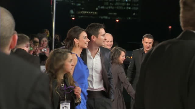 exterior shots frank lampard and christine bleakley posing on red carpet for press then signing autographs for fans. national television awards red... - christine bleakley stock videos & royalty-free footage