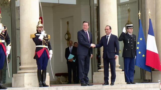 exterior shots french president francois hollande welcomes british prime minister david cameron at the elysee palace, interior shots cameron and... - françois hollande stock videos & royalty-free footage