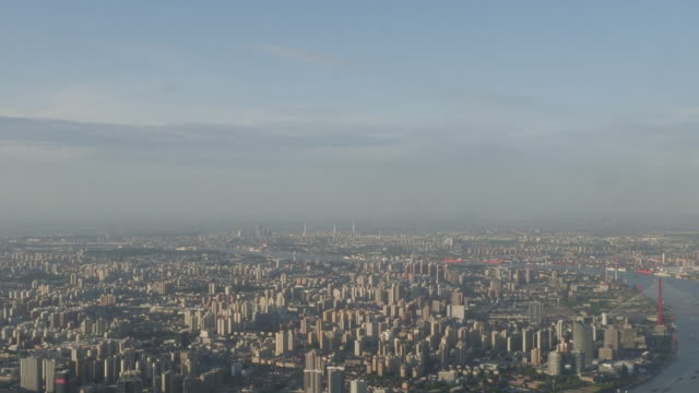 exterior shots from a skyscraper over shanghai's city skyline including the huangpu river and high rise buildings on 28 may 2019 in shanghai china - river huangpu stock videos & royalty-free footage