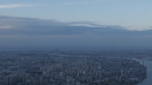 exterior shots from a skyscraper over shanghai's city skyline including the huangpu river and high rise buildings at sunset on 28 may 2019 in... - river huangpu stock videos & royalty-free footage