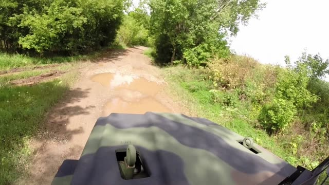 vídeos de stock, filmes e b-roll de exterior shots from industrial trucks driving around in a rural area in cincinatti ohio in fall on 1292014 wide shot of a truck driving over the... - carro blindado