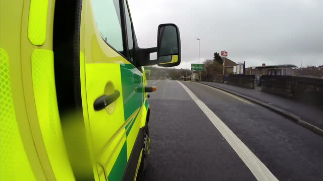 Exterior shots from outside a NHS Ambulance as it drives around busy roads responding to 999 emergency call Filmed with a GoPro Camera on December 17...