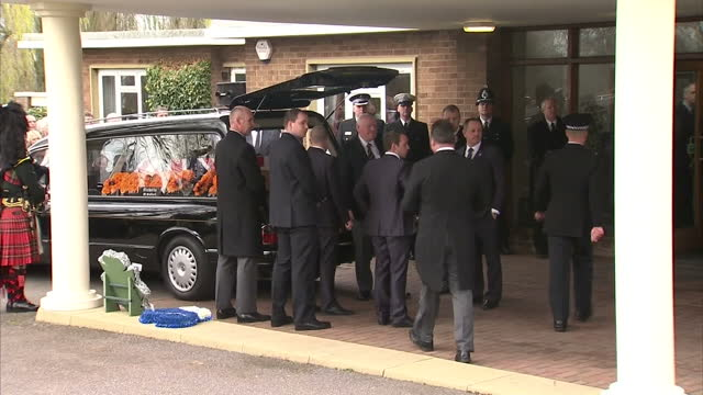 exterior shots funeral hearse carrying pc david rathband arrives at stafford crematorium pc rathband funeral hearse arrival on march 17 2012 in... - stafford england stock videos and b-roll footage