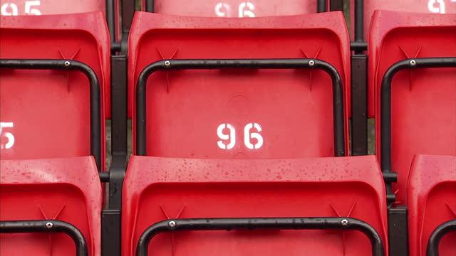exterior shots generic empty red football stadium seats. on in liverpool, england. - ゴールを狙う点の映像素材/bロール