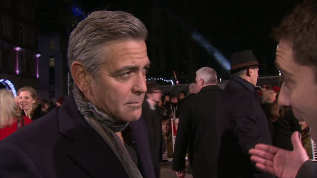 Exterior shots George Clooney actor and director of 'The Monuments Men' talking at premiere about moving away from acting and into directing on in...