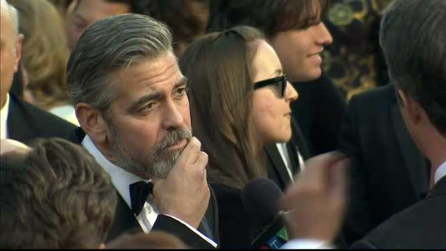 Exterior shots George Clooney chats to reporters on the red carpet George Clooney on the Red Carpet at Dolby Theatre on February 25 2013 in Hollywood...