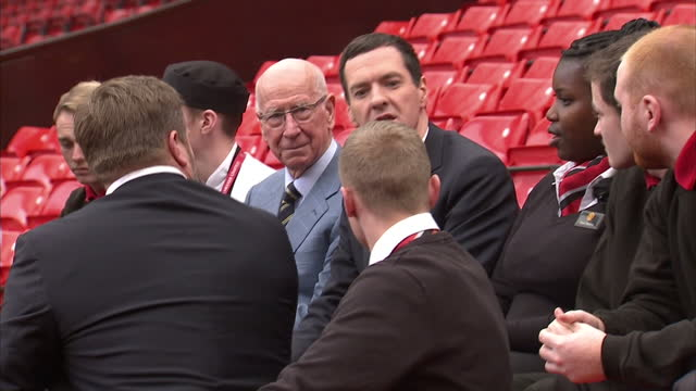 exterior shots george osborne chancellor of the exchequer sitting in stands at old trafford talking with members of the manchester united... - チャンセラー点の映像素材/bロール