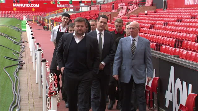 exterior shots george osborne chancellor of the exchequer walking and talking with sir bobby charlton and richard arnold managing director manchester... - チャンセラー点の映像素材/bロール