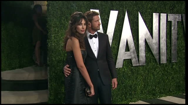 Exterior shots Gerard Butler and Madalina Ghenea Vanity Fair Party arrivals on February 24 2013 in Los Angeles California