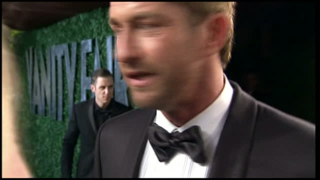Exterior shots Gerard Butler chatting to press Vanity Fair Party Arrivals on February 24 2013 in Los Angeles California