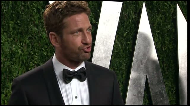 Exterior shots Gerard Butler poses on carpet for press Vanity Fair Party arrivals on February 24 2013 in Los Angeles California