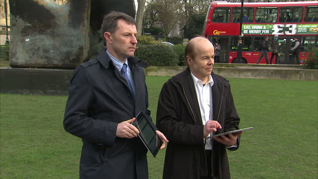 exterior shots gerry mccann & chris jeffries stood on abingdon green in westminster signing e petition. exterior shot gerry mccann chats with hugh... - petition stock videos & royalty-free footage