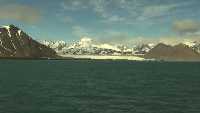 exterior shots glacier meets the isfjorden fjord along the svalbard coastline with large chunks of ice floating in the sea on july 12 2016 in... - svalbard and jan mayen stock videos & royalty-free footage