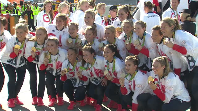 exterior shots gold medal winning team gb womens hockey team posing for team photos in front of british airways flight ba2016 with gold medals after... - field hockey stock videos and b-roll footage