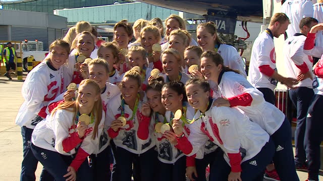 exterior shots gold medal winning team gb womens hockey team posing for team photos in front of british airways flight ba2016 with gold medals after... - gold medal stock videos & royalty-free footage