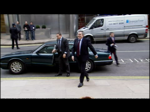 exterior shots gordon brown arrives at the thomson reuters building ahead of his announcement that the 2010 budget will be in 2 weeks making the... - reuters stock videos & royalty-free footage