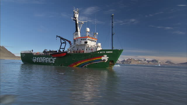 exterior shots greenpeace 'arctic sunrise' vessel in the isfjorden fjord of the coast of svalbard. on july 12, 2016 in longyearbyen, norway. - greenpeace stock videos & royalty-free footage