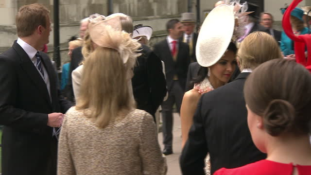 Exterior shots guests arrive at Westminster Abbey including Holly Branson Dave Clark Sky News Royal Wedding Celebration Footage at Various Locations...