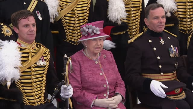exterior shots her majesty the queen marks 70 years of the king's troop royal horse artillery. the queen sits for photoi op with various senior... - king royal person stock videos & royalty-free footage